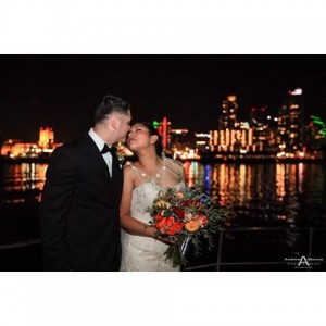 Newlyweds loving kiss aboard Yacht Renwon for a nautical weddinghellip