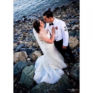 Beautiful bride and groom on a rocky pebble beach inhellip