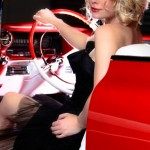 Blonde girl with black dress in 1959 Cadillac