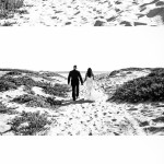 Three panel black and white wedding images of couple walking to the ocean