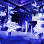 hree girls in white dresses onstage during a magician's performance at Prudential International Insurance Conference at the Manchester Grand Hyatt, San Diego, California.