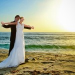 Bride and Groom on a sunset beach in La Jolla California, by San Diego Wedding Photographer Andrew Abouna-