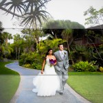 Bride and Groom walking on path at Catamaran Resort Wedding by Wedding Photographer in San Diego Andrew Abouna-