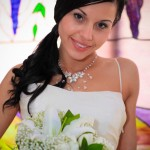 Bride with black hair parted to side and wearing beaded necklace and thin strap wedding dress by San Diego Wedding Photographer Andrew Abouna-2