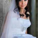 Bride with long black wedding hair style wedding veil straight across wedding dress and beaded waist belt by San Diego Wedding Photographer Andrew Abouna-
