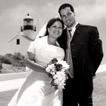 Bride with short sleeve wedding dress and groom wirh suite and vest at point loma lighthouse in black and white by San Diego Wedding Photographers Andrew Abouna-