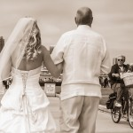 Bride with strapless corset back wedding dress with veil walking with father and dog watching in sepia by San Diego Wedding Photographers Andrew Abouna