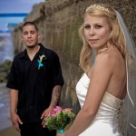 Bride with strapless corset wedding dress with veil and Groom with Lily boutonniere by San Diego Wedding Photographers Andrew Abouna