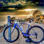 Fujibikes SST in white and blue and Reynolds wheels with road and dramatic sky and clouds in background by San Diego Photographer Andrew Abouna