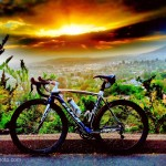 Fujibikes SST in white and blue and Reynolds wheels with yellow sunset sky and clouds in background by San Diego Photographer Andrew Abouna