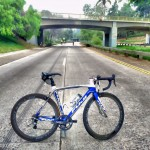Fujibikes SST road bike standing still on historic freeway SR-163 in San Diego California by San Diego Photographer Andrew Abouna