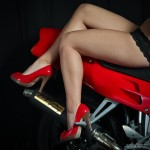 Girls legs on red motorcycle by San Diego Photographer Andrew Abouna