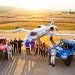 Gordon and Fiberwerx trophy trucks with AeroMedEvac air ambulance learjet with crew at sunset by San Diego photographer Andrew Abouna