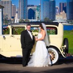 Newlyweds with old car across San Diego Bay by AbounaPhoto