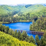 Railroad bridge across Oregon lake with pine tree hills by San Diego Photographer Andrew Abouna-7782