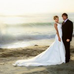 Scoop neck wedding dress with long train for bride and groom at beach wedding by San Diego Wedding Photographer Andrew Abouna