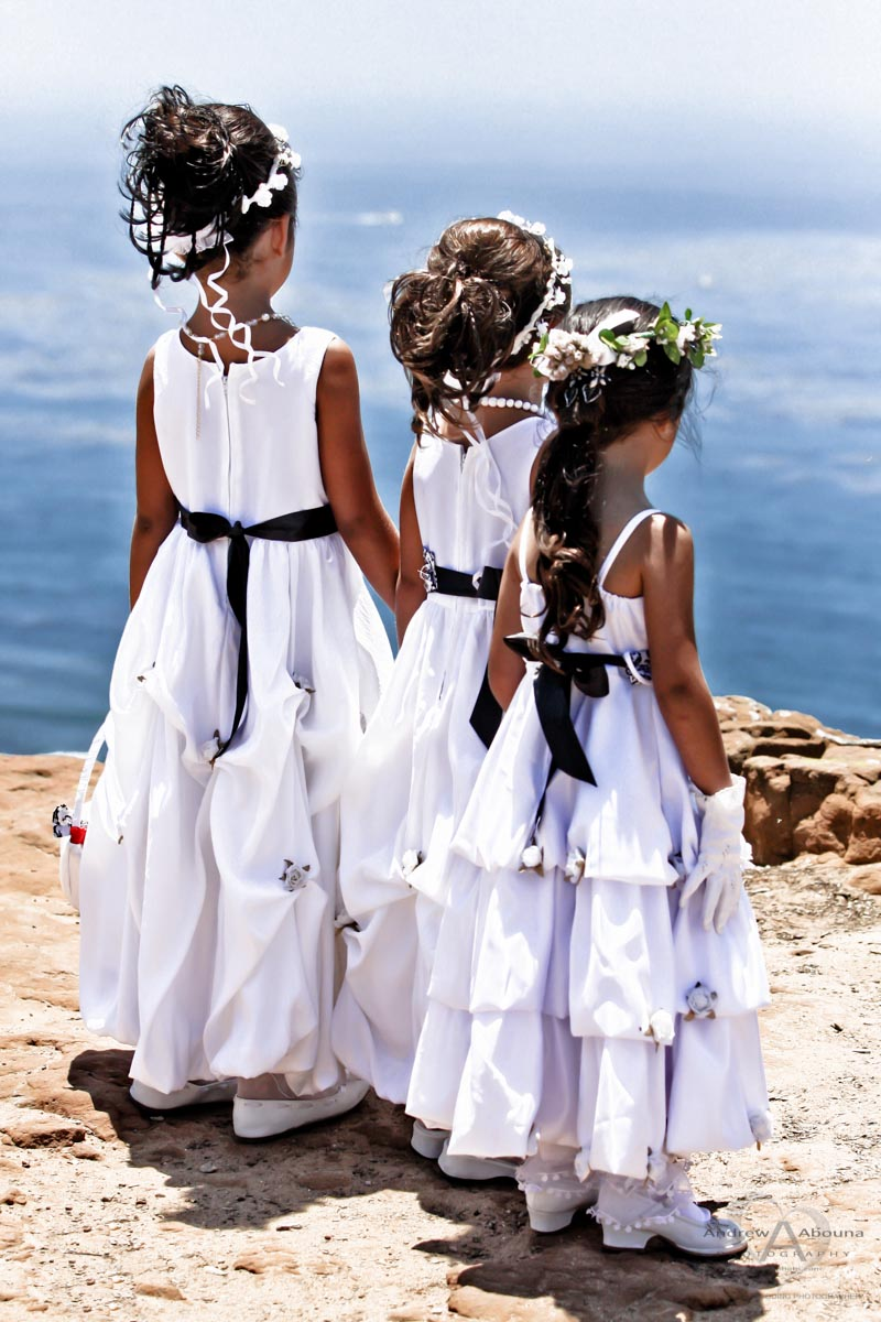 Three Flower Girls Each In A White Dress With Black Sash With Hair