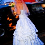 Wedding Dress and Red Umbrella in Rain by San Diego Wedding Photographer Andrew Abouna