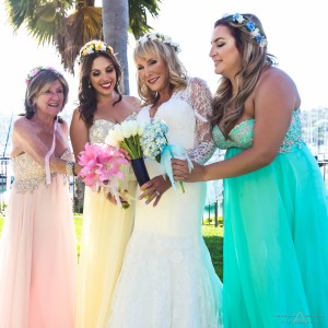 Lovely bridesmaid dresses, each a different color by San Diego Wedding Photographers Andrew Abouna