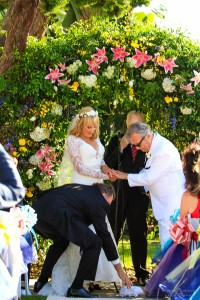 "in Jewish tradition, at the end of the ceremony a glass was placed at the foot of the groom, and Rick crushed it with his foot, and the guests shouted ""Mazel tov!"" (""Congratulations"")! by San Diego Wedding Photographers Andrew Abouna"