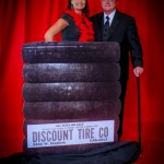 posed-onsite-event-and-portrait-background-ideas-red-background-with-vignette-and-tire-prop-and-couple-abounaphoto-2-414x580